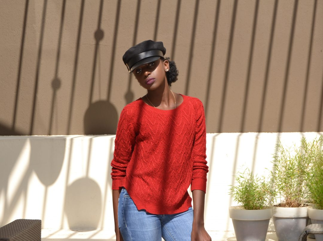 red sweater, bell bottoms and baker boy hat